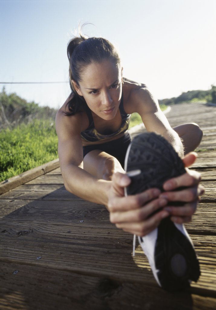 Stock Photo: 1660R-11253 Close-up of a mid adult woman exercising