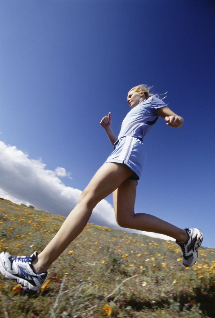 Stock Photo: 1660R-11262 Low angle view of a young woman jogging