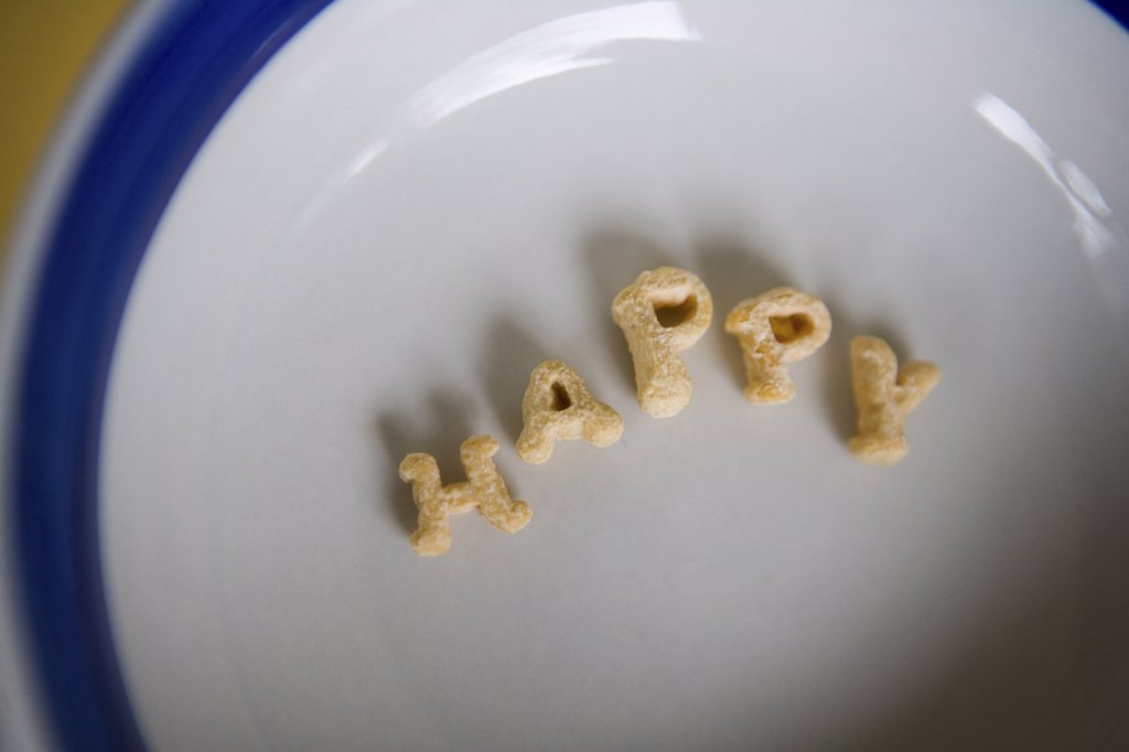 Stock Photo: 1660R-11484 Close-up of alphabet shaped cereal on a plate