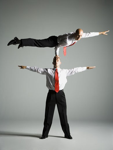 Stock Photo: 1660R-11806 Two male acrobats in business suits