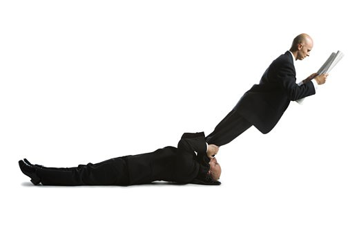 Stock Photo: 1660R-11807 Profile of two male acrobats in business suits