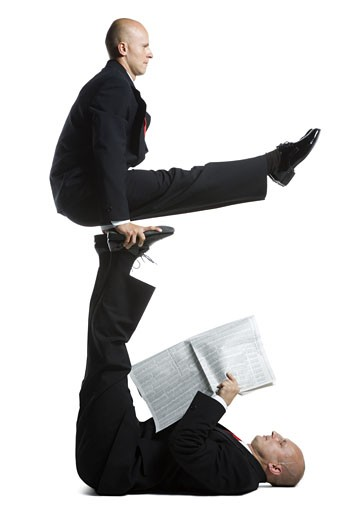 Stock Photo: 1660R-11811 Two male acrobats in business suits performing