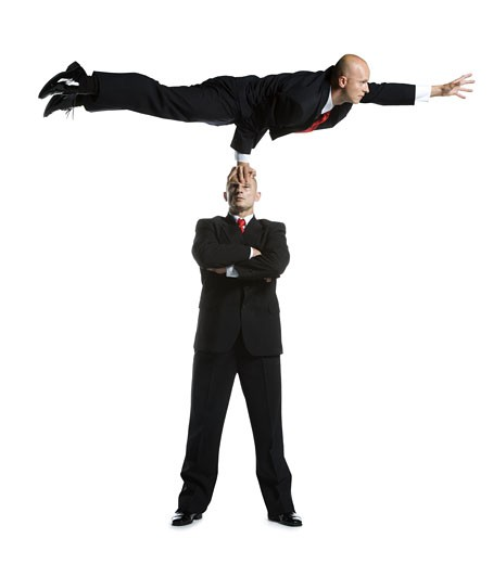 Stock Photo: 1660R-11812 Two male acrobats in business suits performing