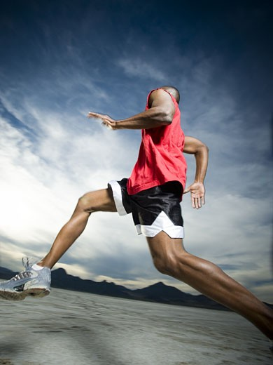 Stock Photo: 1660R-11819 Man Jogging on the Salt Flats