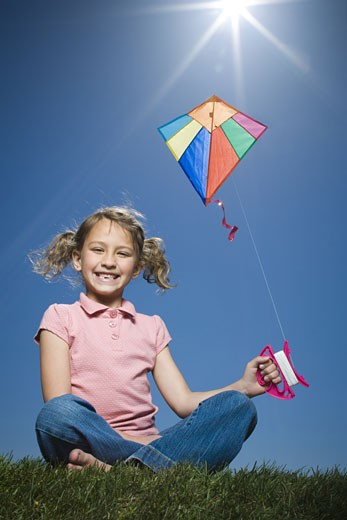 Stock Photo: 1660R-11833 Portrait of a girl flying a kite
