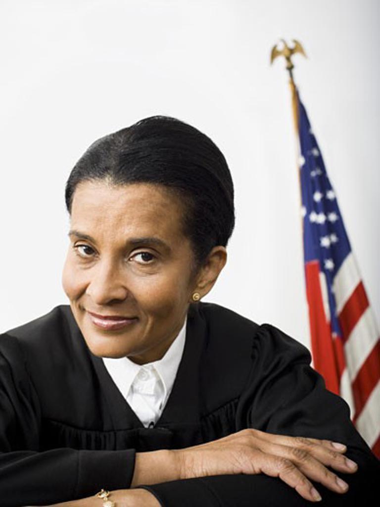 Portrait of a female judge smiling : Stock Photo