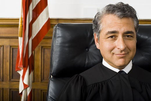 Portrait of a male judge smiling : Stock Photo