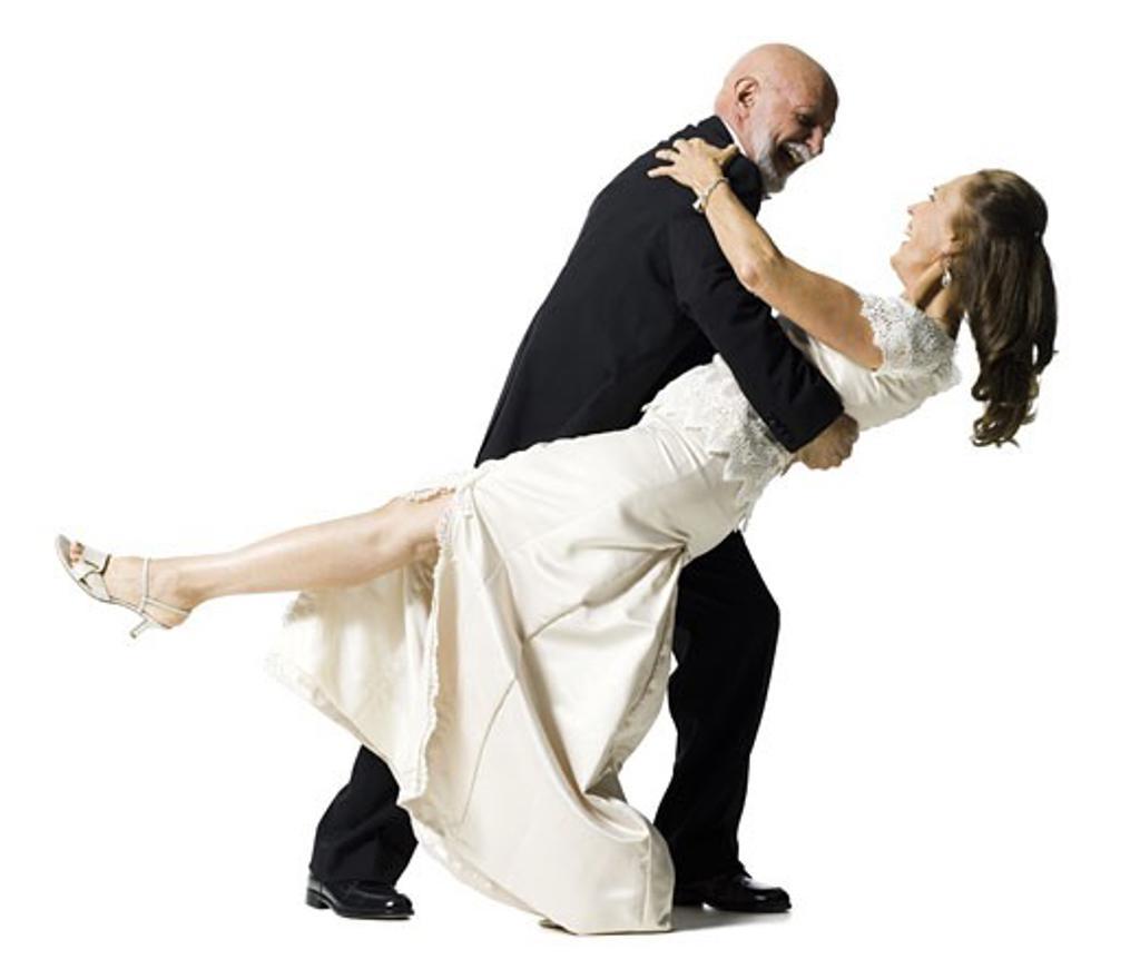 Profile of a senior couple dancing : Stock Photo