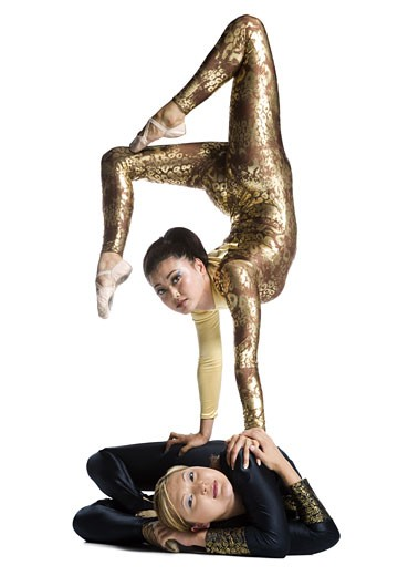Stock Photo: 1660R-11959 Female contortionist duo performing
