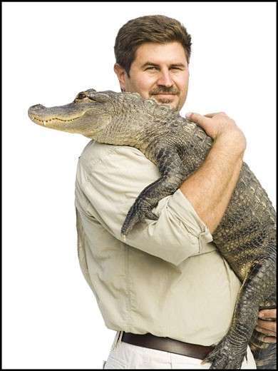 Stock Photo: 1660R-12033 Animal handler with alligator