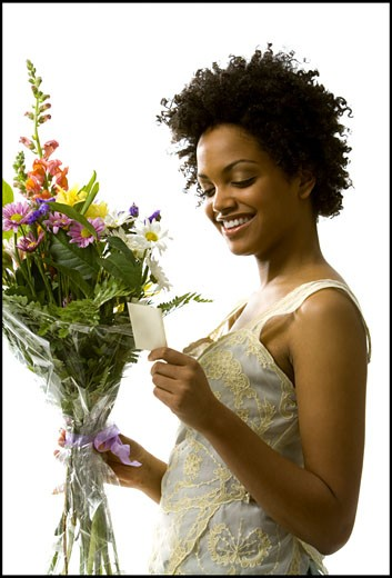 Woman receiving bouquet of flowers : Stock Photo