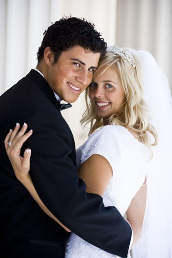 Newlywed bride and groom : Stock Photo