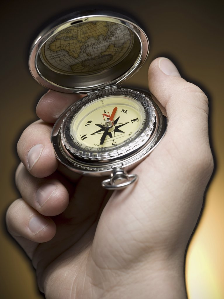 Close-up of a person holding a compass : Stock Photo