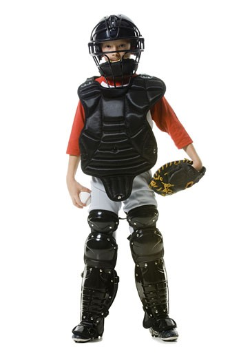 Stock Photo: 1660R-12128 Portrait of a baseball catcher standing