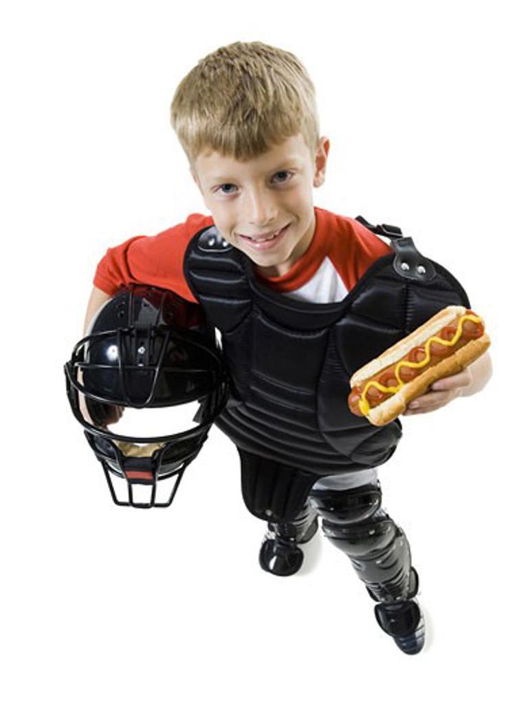 High angle view of a baseball catcher holding a baseball helmet : Stock Photo
