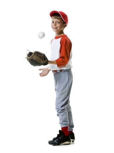Portrait of a baseball player tossing a baseball : Stock Photo