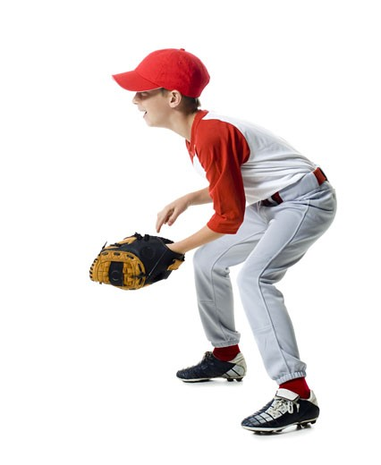 Stock Photo: 1660R-12142 Profile of a baseball player standing in a catching position