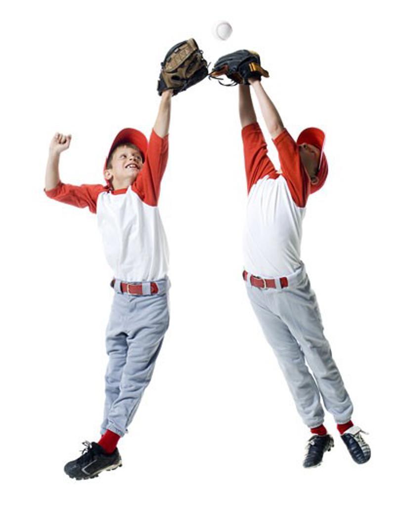 Two baseball players jumping : Stock Photo