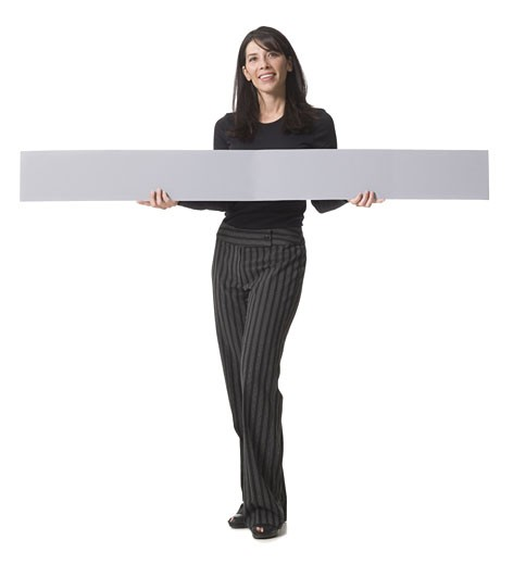 Stock Photo: 1660R-12151 Portrait of a mid adult woman holding a blank sign