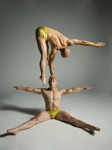Stock Photo: 1660R-12155 Two male acrobats performing