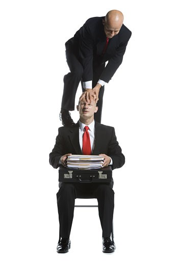 Stock Photo: 1660R-12167 Two male acrobats in business suits performing
