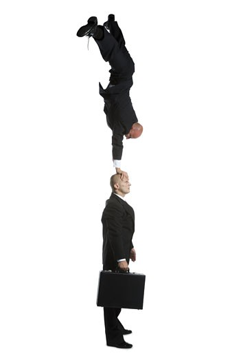 Stock Photo: 1660R-12169 Profile of two male acrobats in business suits performing