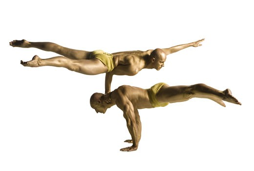 Stock Photo: 1660R-12174 Profile of two male acrobats performing