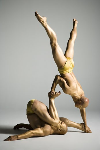 Stock Photo: 1660R-12178 Two male acrobats performing