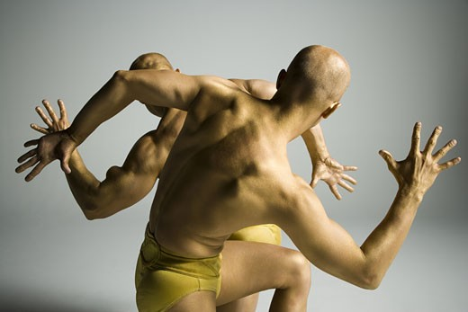 Stock Photo: 1660R-12190 Rear view of two male acrobats performing