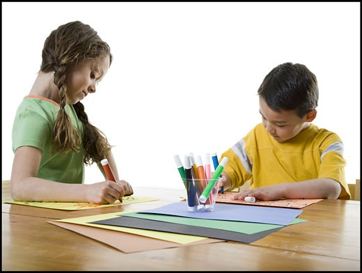 Stock Photo: 1660R-12274 Close-up of a girl and her brother drawing on papers with felt tip pens
