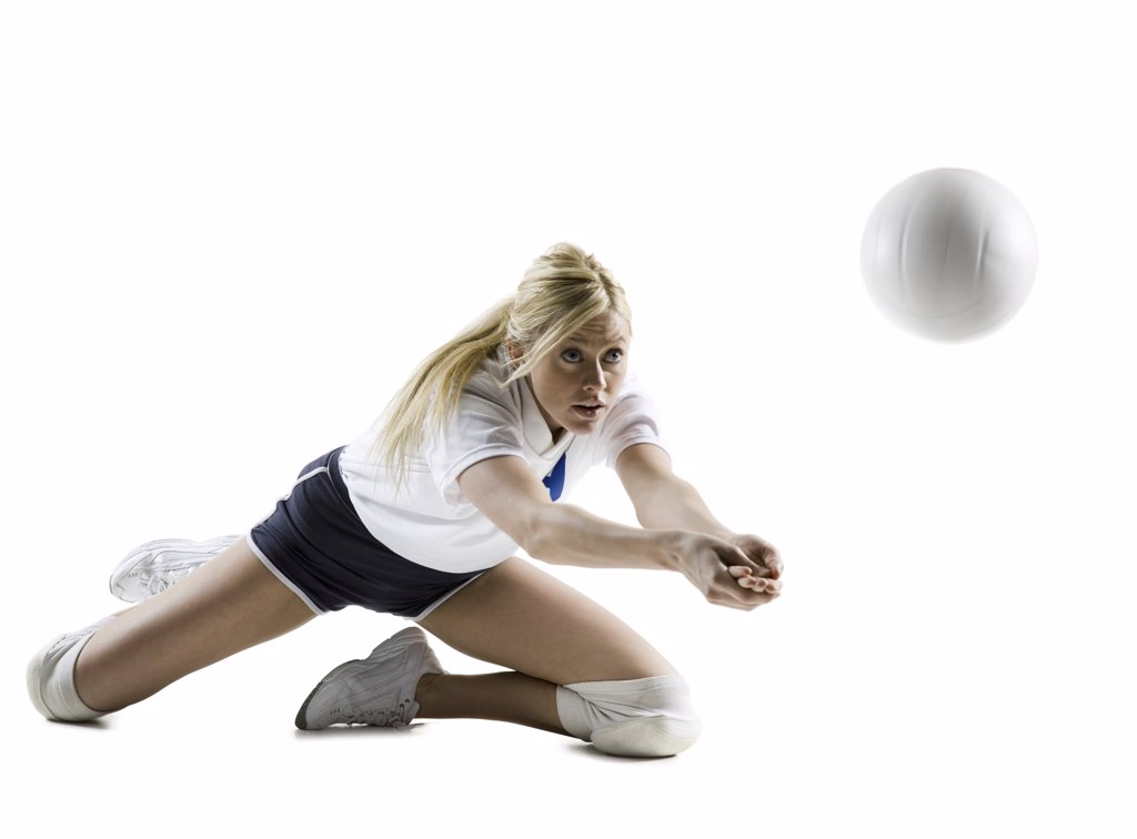 Close-up of a young woman playing volleyball : Stock Photo