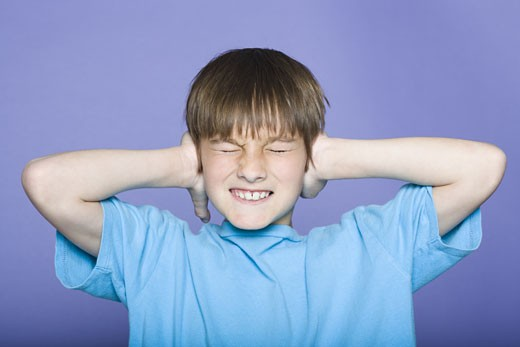 Stock Photo: 1660R-12456 Close-up of a boy covering his ears