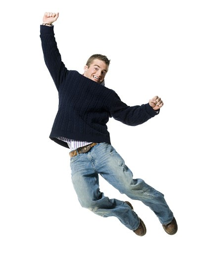Portrait of a young man jumping in mid air : Stock Photo
