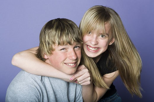 Stock Photo: 1660R-12525 Portrait of a teenage boy and a teenage girl smiling