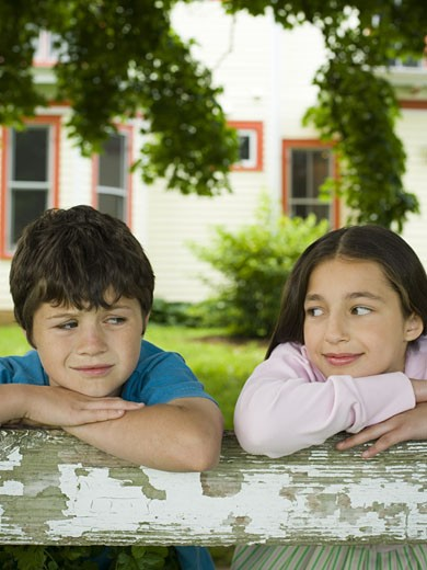 Stock Photo: 1660R-12626 Close-up of a boy and a girl looking sideways