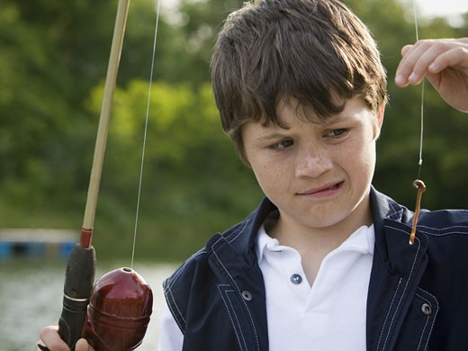 Stock Photo: 1660R-12691 Close-up of a boy holding a fishing rod