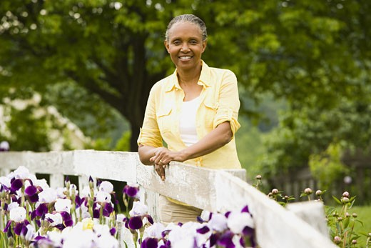 Stock Photo: 1660R-12769 Portrait of a senior woman next to a fence