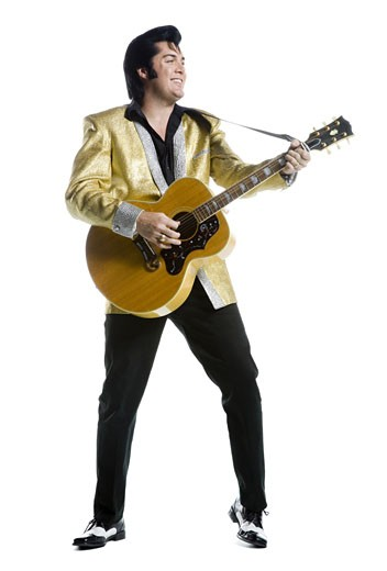 Stock Photo: 1660R-12832 An Elvis impersonator playing the guitar