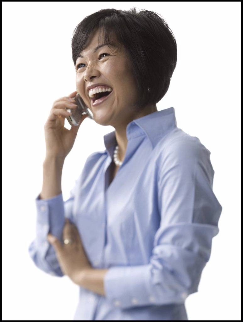 Stock Photo: 1660R-1285 Close-up of a mid adult woman talking on a mobile phone