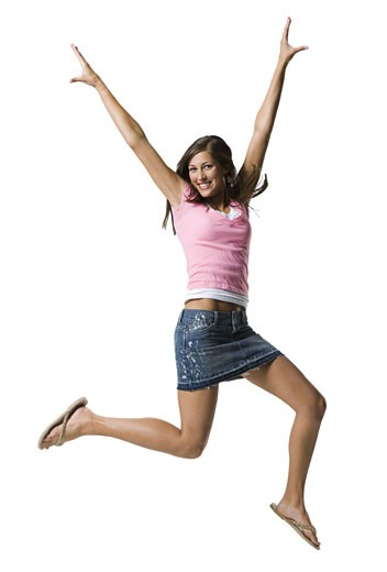 Stock Photo: 1660R-12856 A young woman jumping and smiling
