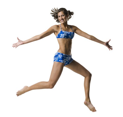 Stock Photo: 1660R-12867 A young woman jumping