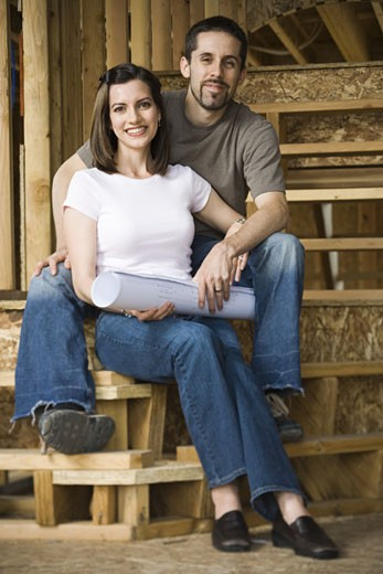 Stock Photo: 1660R-12905 Portrait of a young couple sitting on the staircase and smiling