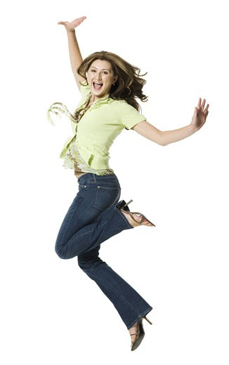 Stock Photo: 1660R-12967 A young woman jumping