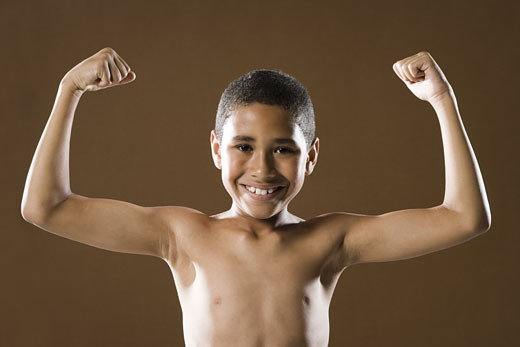 Stock Photo: 1660R-12985 Portrait of a boy flexing his muscles