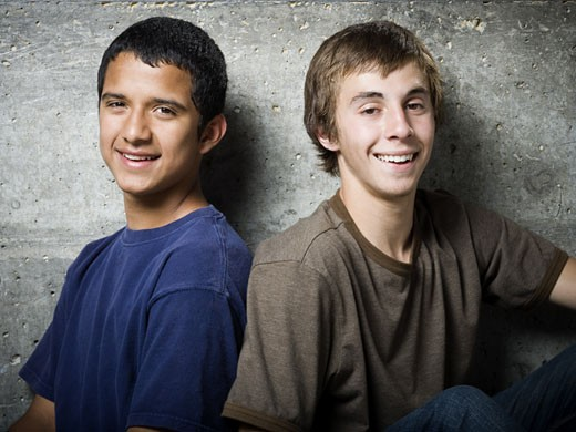 Portrait of two teenage boys smiling : Stock Photo
