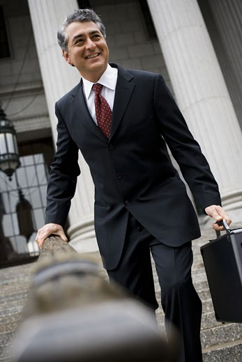Stock Photo: 1660R-13104 Low angle view of a man walking down the steps of a courthouse