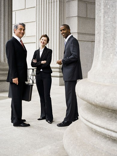 A Portrait of three lawyers in front of a courthouse : Stock Photo