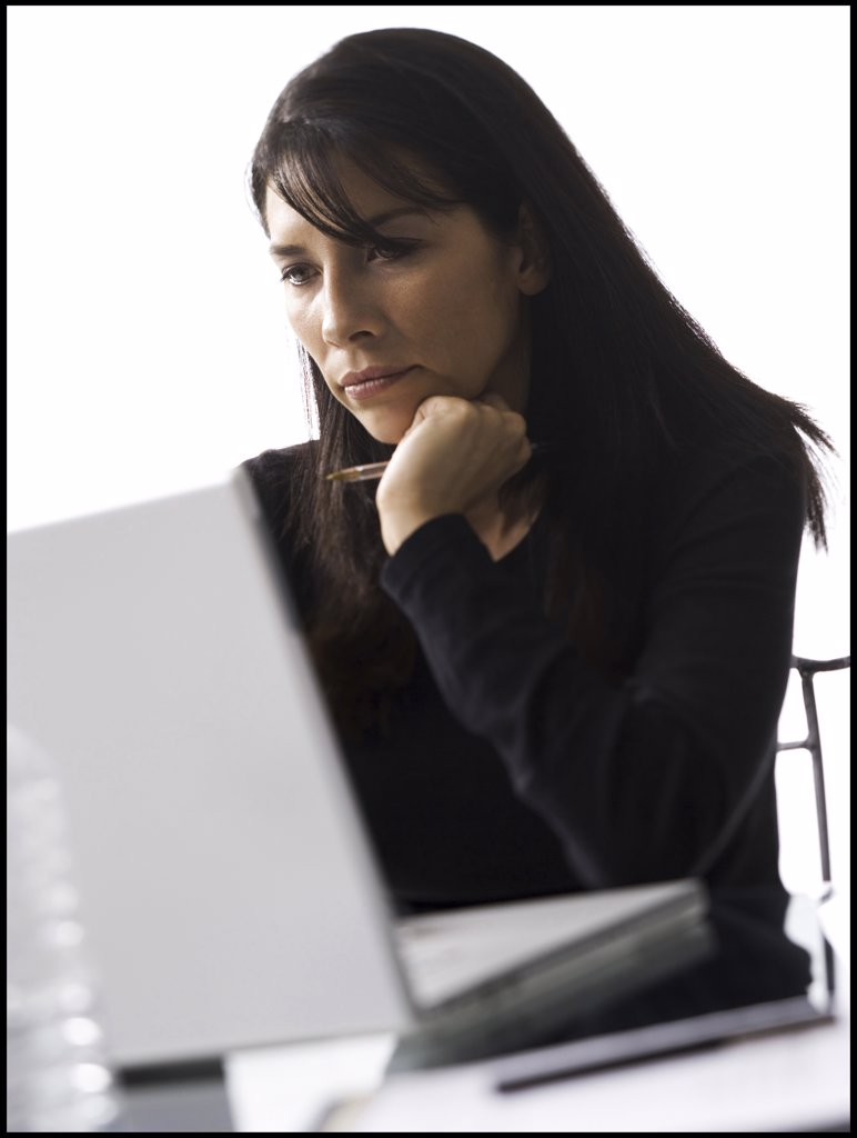 Stock Photo: 1660R-1313 Close-up of a mid adult woman using a laptop