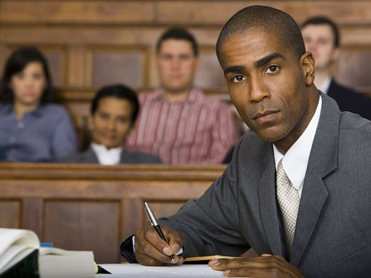 Stock Photo: 1660R-13149 Portrait of a male lawyer sitting in a courtroom