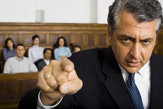 Stock Photo: 1660R-13153 Portrait of a male lawyer pointing